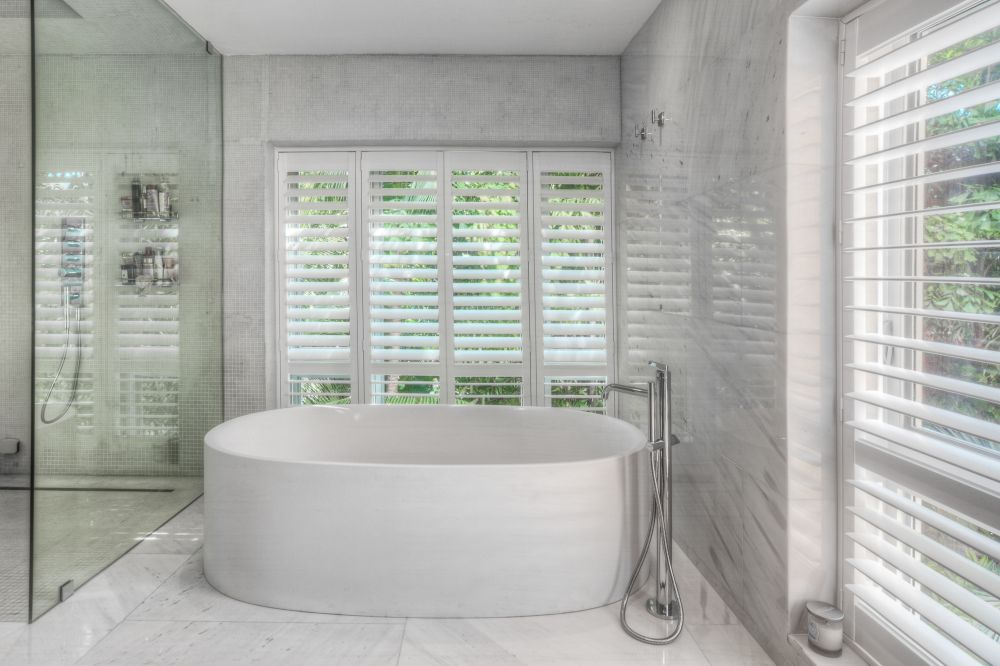 Residential bathroom with plantation shutters